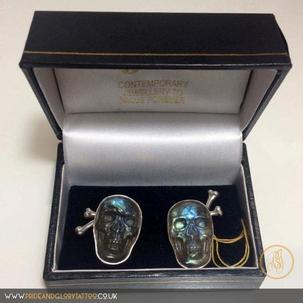Handmade silver cufflinks set with labradorite skulls and crossbone backs by Lance Vinten for
