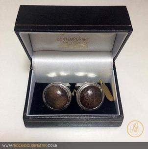 Handmade silver cufflinks set with large round dinosaur bone by Lance Vinten for