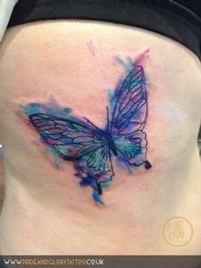 Abstract water colour butterfly tattoo
