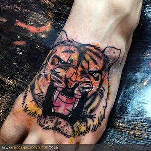 Abstract watercolour tiger tattoo by Chessie at Pride & Glory