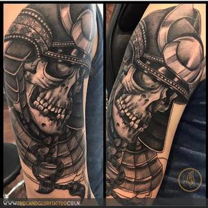 Black and grey dead samurai skull tattoo by  Pride and Glory tattoo studio, Leigh-on-sea Essex, UK.