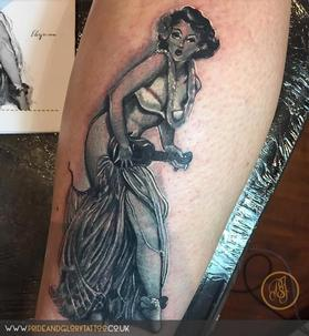 Black and grey Hula girl Elvgren pin up tattoo by Chessie Clear at Pride and Glory tattoo studio, Leigh-on-sea, Essex Uk.