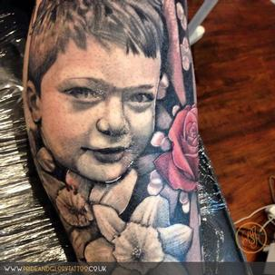 Black and grey realism portrait tattoo by Chessie at Pride & Glory tattoo studio, Leigh-on-sea Essex.