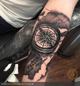 Black and grey realistic compass and atlas tattoo by Chessie Clear at Pride & Glory tattoo studio, Leigh-on-sea, Essex, UK