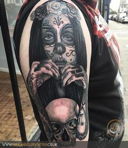Black and grey realistic day of the dead portrait tattoo of Monami Frost with skull by Chessie Clear at Pride & Glory tattoo studio, Leigh-on-sea, Essex, UK