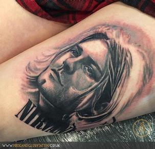 Black and grey realistic Kurt Cobain portrait Nirvana tattoo by Chessie Clear at Pride & Glory tattoo studio, Leigh-on-sea, Essex UK