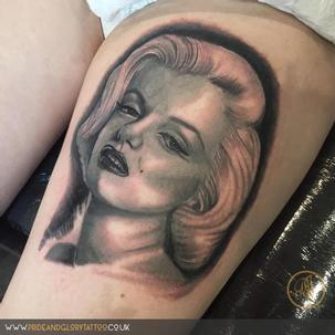 Black and grey realistic Marilyn Monroe portrait thigh tattoo by Chessie Clear at Pride & Glory tattoo studio, Leigh-on-sea, Essex, UK