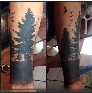 Black work forest of trees and bird silhouettes tattoo by Chessie Clear at Pride & Glory tattoo studio Leigh-on-sea, Essex.
