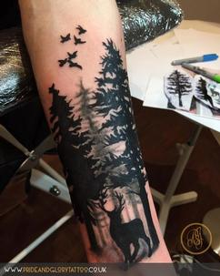 Black work forest trees and stag tattoo by Chessie Clear at Pride and glory tattoo studio, Leigh-on-sea, Essex. UK