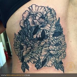 Black work peonies cover up tattoo by Chessie Clear at Pride and Glory tattoo studio, Leigh-on-sea Essex. UK