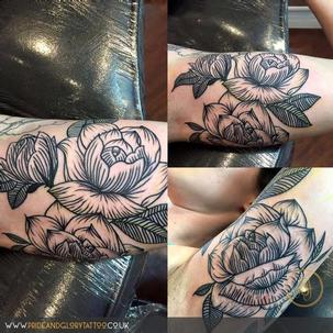 Black work roses tattoo added to black work floral tattoo half sleeve by Chessie Clear at Pride and glory tattoo studio, Leigh-on-sea, Essex, Uk.