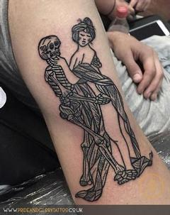 Black work woodcut style woman dancing with skeleton black tattoo, by Chessie Clear at Pride & Glory tattoo studio, Leigh-on-sea, Essex, UK.