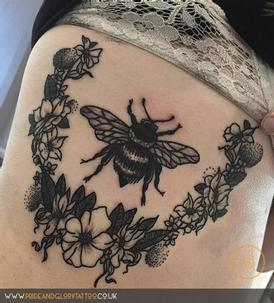 Blackwork flower wreath and bumblebee tattoo by Chessie Clear, at Pride and Glory tattoo studio, Leigh-on-sea, Essex. UK