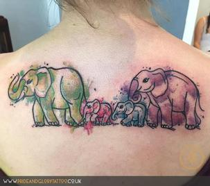 Cartoon watercolour elephants tattoo by Chessie Clear at Pride and Glory tattoo studio, Leigh-on-sea Essex UK.