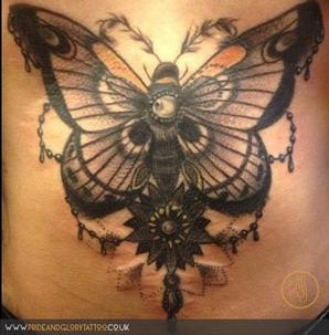 Close up of detail neo traditional moth stomach tattoo