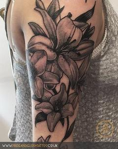 Custom Neo traditional lilies flower tattoo by Chessie Clear at Pride and Gory tattoo studio Leigh-on-sea Essex. UK