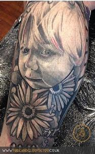 Finished portrait tattoo as part of a large leg tattoo by Chessie at Pride & Glory tattoo studio, Leigh-on-sea Essex.
