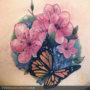 Girly flowers and butterfly cover up tattoo, by Chessie Clear at Pride and Glory tattoo studio, Leigh-on-sea, Essex. UK