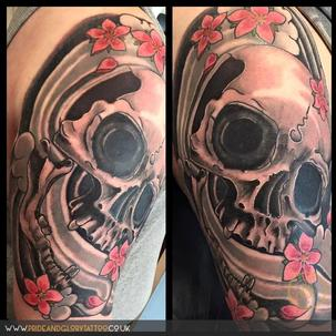 Japanese skull and cherry blossom cover up tattoo half sleeve by Chessie Clear at Pride and Glory tattoo studio, leigh-on-sea, Essex, UK.