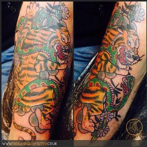 Japanese tiger and snake tattoo