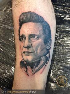 Johnny Cash portrait tattoo by Chessie at Pride & Glory