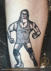 Mr Perfect retro wrestling figure tattoo by Chessie Clear at Pride and Glory tattoo studio, Leigh-on-sea, Essex. UK