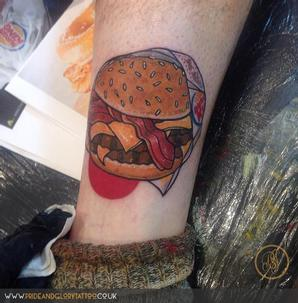 Neo traditional burger tattoo by Chessie Clear at Pride & Glory tattoo studio, Leigh-on-sea Essex.