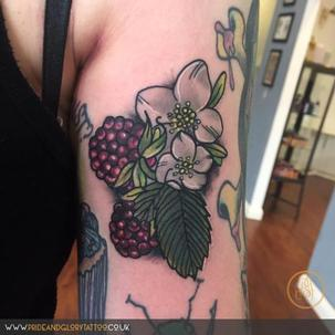 Neo traditional floral raspberry fruit tattoo by Chessie Clear at Pride and Glory tattoo studio, Leigh-on-sea, Essex, UK