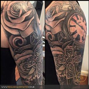 Realistic pocket watch, cross and roses half sleeve black and grey tattoo by Chessie Clear at Pride and Glory tattoo studio, Leigh-on-sea, Essex. UK.