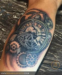 Realistic smashed pocket watch and cogs tattoo, by Chessie Clear at Pride and Glory tattoo studio, Leigh-on-sea, Essex. UK