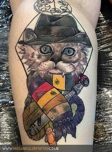 Tom Baker inspired customer Dr. Who Neo Traditional cat tattoo by Chessie at Pride & Glory tattoo studio Leigh-on-sea Essex.