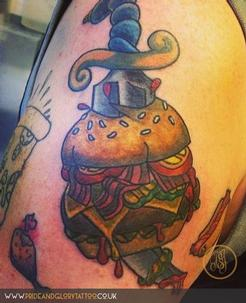 Traditional burger and dagger tattoo