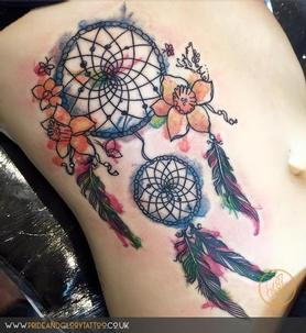 Watercolour dream catcher and daffodil tattoo by Chessie Clear at Pride and Glory tattoo studio, Leigh-on-sea, Essex, UK.