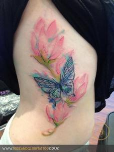 Watercolour flowers and butterfly tattoo, by Chessie at Pride & Glory tattoo studio, Leigh-on-sea Essex.