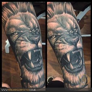 Realistic black and grey lion portrait tattoo by Chessie Clear at Pride and Glory tattoo studio, Leigh-on-sea, Essex, UK