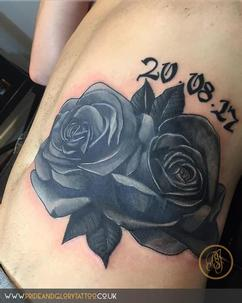 Realistic black roses cover up tattoo by Chessie Clear at Pride & Glory tattoo studio, Leigh-on-sea